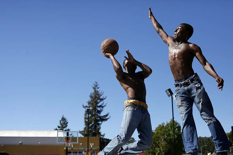 """I don't feel safe in Oakland ... 'cause they treat us like suspects,"" says Gregory Murray (left), with Bloo Foster. Photo: Lacy Atkins, The Chronicle"