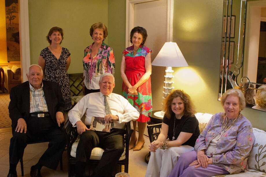 George Murray, center, and Ann Dunphy Becker, second from right, were helped by longtime River Oaks residents when they wrote a book about the subdivision. Helping in the project were former state appeals court judge Paul Pressler, left, Susan Clayton Garwood, back left, Rhetta Moody McAlister,  Sarah Rothermel Duncan and, far right, Francita Ulmer. Photo: R. Clayton McKee, Freelance / © R. Clayton McKee