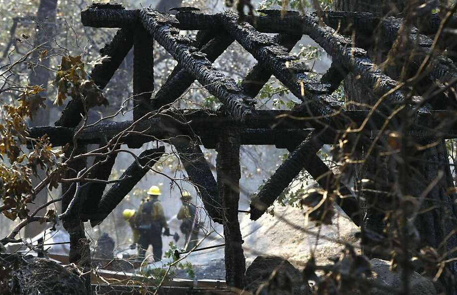 Firefighters douse hot spots amid the smoldering ruins of the Berkeley Tuolumne Camp, which was almost completely destroyed by the Rim Fire. Photo: Don Bartletti, McClatchy-Tribune News Service