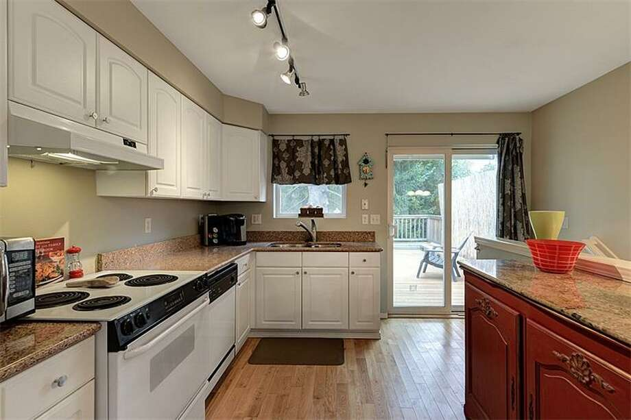 Kitchen of 3519 S.W. Monroe St. It's listed for $400,000. Photo: Courtesy Realogics Sotheby's International Realty