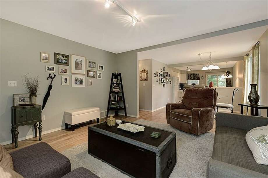 Living room of 3519 S.W. Monroe St. It's listed for $400,000. Photo: Courtesy Realogics Sotheby's International Realty