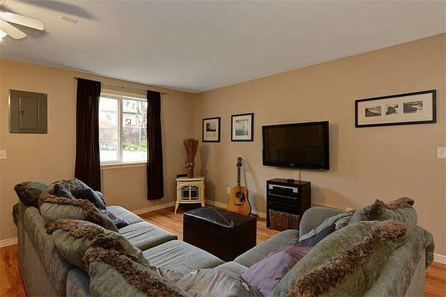Family room of 3519 S.W. Monroe St. It's listed for $400,000. Photo: Courtesy Realogics Sotheby's International Realty