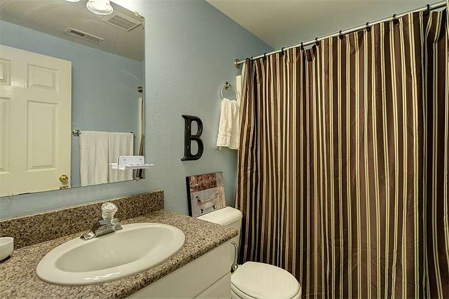Bathroom of 3519 S.W. Monroe St. It's listed for $400,000. Photo: Courtesy Realogics Sotheby's International Realty