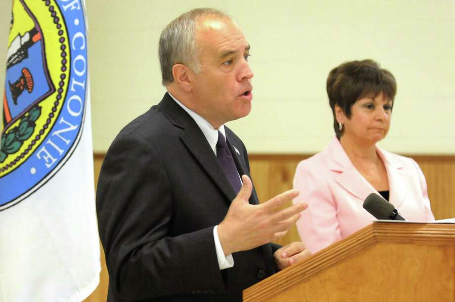 State Comptroller Tom DiNapoli, left, addresses the financial state of the Town of Colonie on Tuesday, Aug. 27, 2013, at Colonie Town Hall in Colonie, N.Y. Joining him is Town Supervisor Paula Mahan. (Cindy Schultz / Times Union) Photo: Cindy Schultz / 00023656A