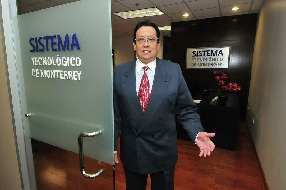 Albert Onofre (Executive Director of International and Public Relations) opens the doors to the Sistema Tecnologico de Monterrey and their Houston offices Thursday 8/08/13. Photo: Â Tony Bullard 2013, Freelance Photographer / © Tony Bullard & the Houston Chronicle