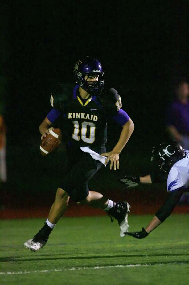 Kinkaid quarterback J T Granato looks for an open receiver as he moves through the back field Friday night. Photo: Matthew White, Freelance / Freelance