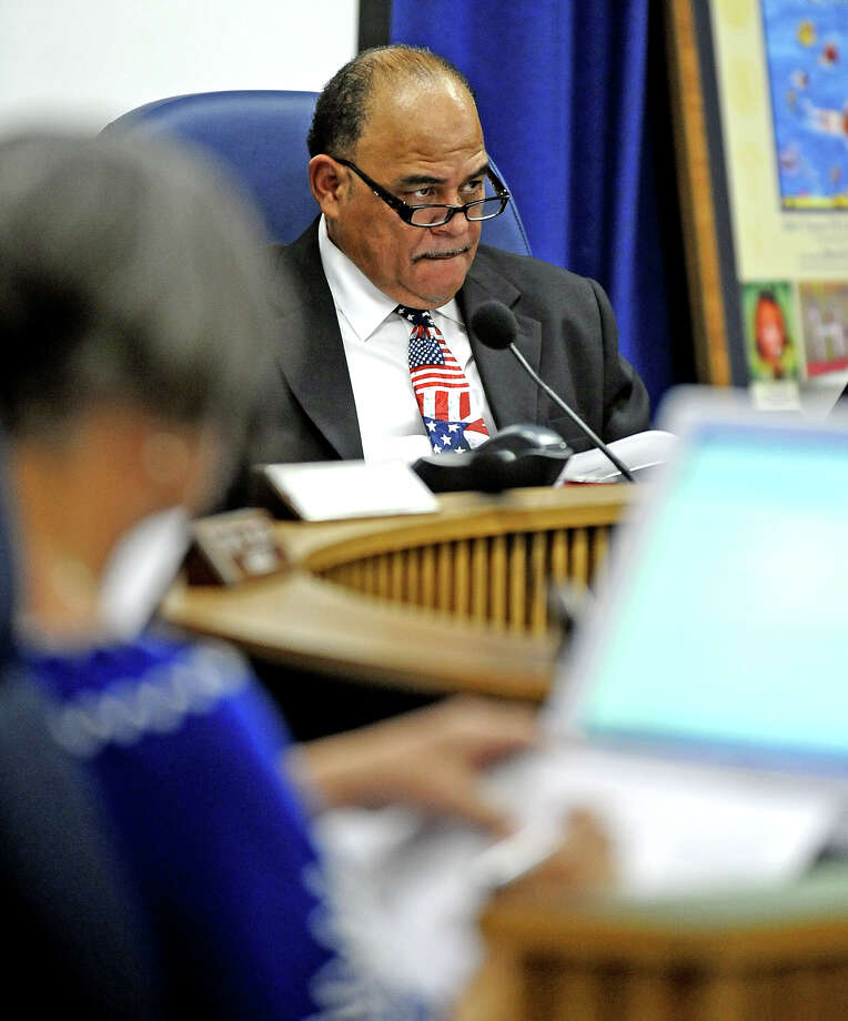 Board President Woodrow Reece looks on as Dr. Shirley Bonton discusses the Legislative Budget Board report during the BISD public hearing meeting on Thursday, August 22, 2013.