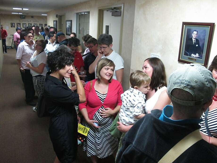 Dozens of couples line up outside the Bernalillo County clerk's office in Albuquerque. Same-sex marriage licenses are also being issued in the Santa Fe and Las Cruces areas. Photo: Russell Contreras, Associated Press