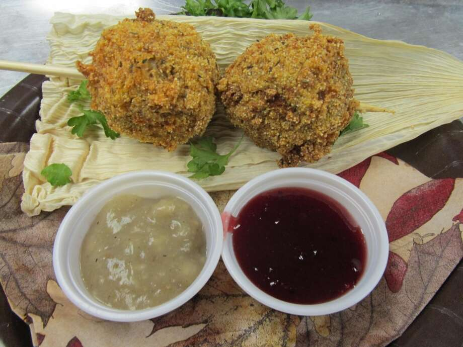 Fried Thanksgiving Dinner  – Mama's homemade stuffing and diced roasted turkey are rolled in a ball.   Next it's dipped in southern cream corn and rolled in seasoned corn meal - all fried to a crispy golden brown. Served with old fashion giblet brown gravy.   There is a zesty orange cranberry sauce for dipping. (Credit State Fair of Texas)