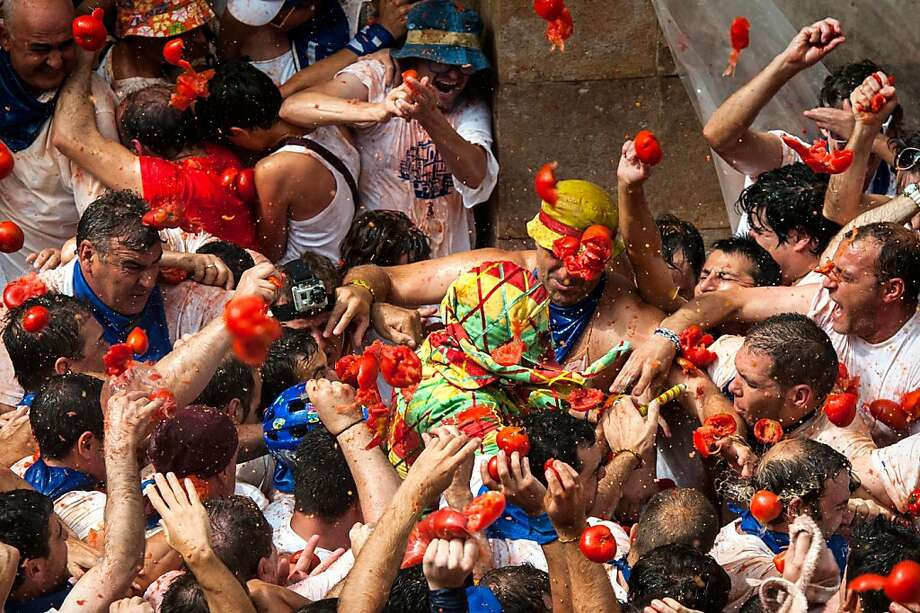 Tomato gantlet:In an annual tradition that dates back to the 18th century, the   civilians of Tarazona, Spain, pelt a harlequin character known as the Cipotegato with   tomatoes. Armed only with a short wooden club, the Cipotegato runs through the streets of   Tarazona on a route known only to him, ending in the Plaza de Espana Square, where the   townspeople are waiting with their tomatoes. He must shake off the veggie bombardment, scale a monument and tie a scarf around it, signaling the start of the festival   of Tarazona. Photo: David Ramos, Getty Images