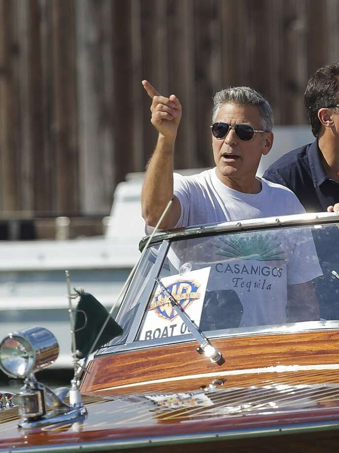 Canal shuttle: George Clooney, noted actor and tequila aficionado, takes a water taxi to the 