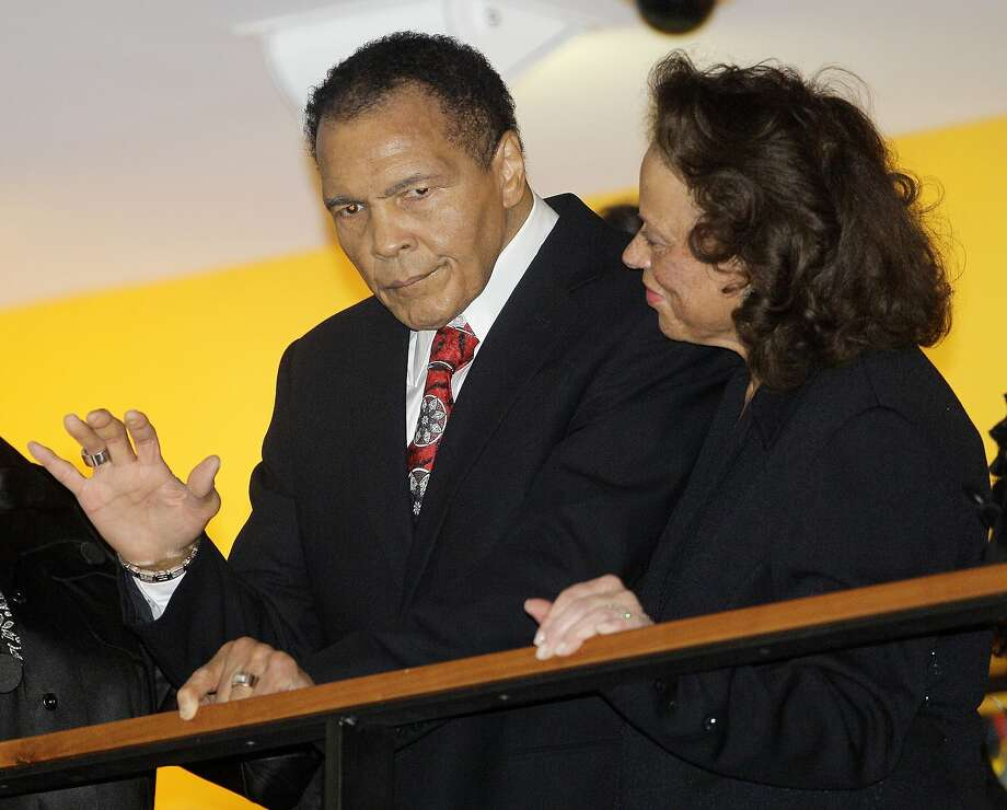 FILE - In this Jan. 14, 2012 file photo, boxing great Muhammad Ali, with his wife, Lonnie, right, waves to friends attending a celebration for his 70th birthday at the Muhammad Ali Center  in Louisville, Ky. Ali wants to recognize some of the greatest humanitarians around the world. The first-ever Muhammad Ali Humanitarian Awards will be presented Oct. 3 in Louisville, Ky. _ the former heavyweight champion's hometown. The Muhammad Ali Center said Tuesday, Aug. 27, 2013, that six awards will honor people ages 35 and under for making significant contributions for peace, social justice and other humanitarian causes. (AP Photo/Mark Humphrey, File) Photo: Mark Humphrey, Associated Press