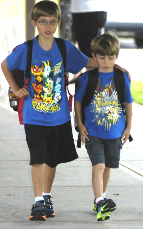 Jordie, left, and Aiden Padros share their entrance to Northville School Monday for the first day of school in New Milford. Aug. 26, 2013 Photo: Norm Cummings