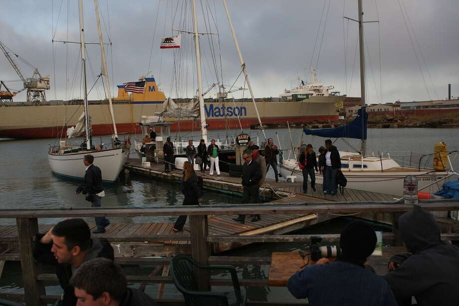 People get off a boat and head to the Ramp in San Francisco. Photo: Liz Hafalia, The Chronicle