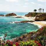 Most beautiful stretch of sand, Laguna Beach Catch Aliso Beach Park on a balmy day when the water turns a translucent turquoise, and you'll think you've been transported south to the tropics. Backed by low hills and cliffs topped by dream homes, the beach looks out on Santa Catalina Island, with low-tide access south around a rocky point to a long, curving stretch of sand. There may be better-known beaches in Orange County but certainly none more beautiful. 31131 S. Pacific Coast Hwy.; ocparks.com/beaches/aliso Read more: Top 10 California coast hotels