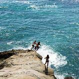 Jumping for joy, Laguna Beach About to make a splash at Laguna Beach.