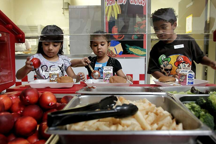 Ariana (left), Olivia and Isaiah move through the lunch line at Sisk Elementary School in Salida (Stanislaus County). Photo: Michael Macor, The Chronicle