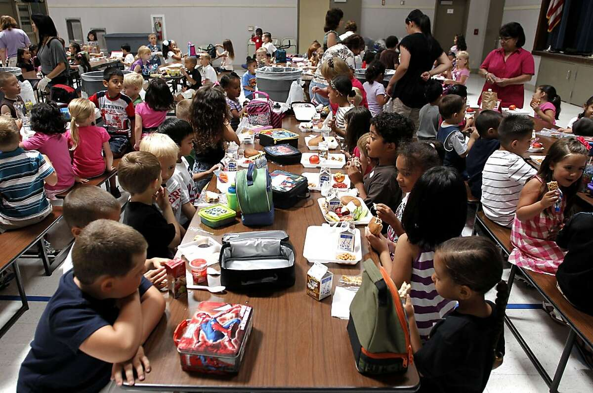 The first day back to school, children at the Sisk Elementary School have lunch in Salida, Ca. on Wednesday August 10, 2011.