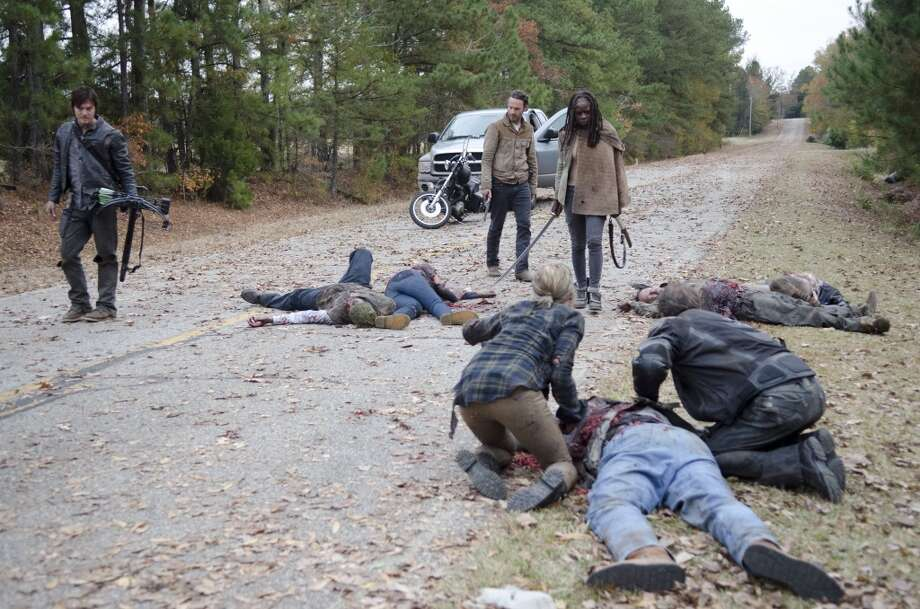 On the way back to Woodbury, the Governor loses it and turns on his own soldiers, killing all but two of them. Rick (Andrew Lincoln) and the group that have left the prison head to Woodbury. On the way they come upon the dead bodies from the massacre. Photo: Gene Page/AMC