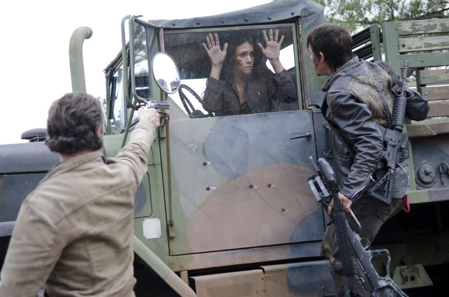 The Governor ran out of bullets before he could kill Karen (Melissa Ponzio). She tells Rick and Daryl (Norman Reedus) about the killings. Photo: Gene Page/AMC