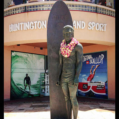 Legends of the surf, Huntington Beach Surf icon Duke Kahanamoku at Huntington Surf and Sport.