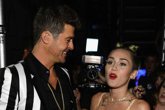 NEW YORK, NY - AUGUST 25:  (EXCLUSIVE COVERAGE) Performers Robin Thicke and Miley Cyrus are seen backage at the 2013 MTV Video Music Awards at the Barclays Center on August 25, 2013 in the Brooklyn borough of New York City.  (Photo by Larry Busacca/Getty Images for MTV)