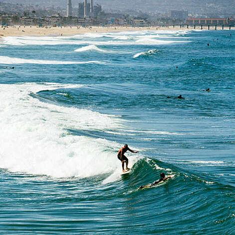Wild ride, Manhattan Beach Surf's up! Read more: Must-do road trip: California's 101   Photo: Thomas J. Story, Sunset.com / ©Thomas J. Story/Sunset Publishing