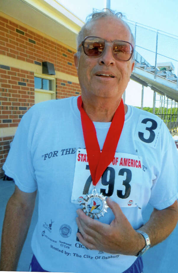 Michael Stein of Danbury competed in the 1,500-meter race walk at the State Games of America on Aug. 4 in Harrisburg, Pa., and won the silver medal in the 65-to-69-year-old men's division. The 67-year-old completed the course at Bishop McDevitt High School in 11 minutes, 37.77 seconds. Photo: Contributed Photo / The News-Times Contributed