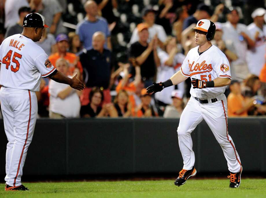 Baltimore Orioles' Lew Ford (51) rounds the bases as he is greeted by third base coach DeMarlo Hale (45) after hitting a home run during the third inning of a baseball game against the Chicago White Sox, Tuesday, Aug. 28, 2012, in Baltimore. (AP Photo/Nick Wass) Photo: Nick Wass, FRE / AP2012