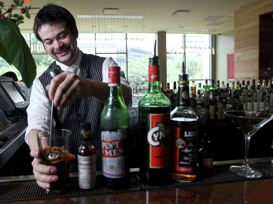 Chris Frankel, the new bar manager for RDG & Bar Annie, mixes up cocktails that are variations on classics to accompany tastes from the bar menu. Photo: Karen Warren, Staff / © 2013 Houston Chronicle