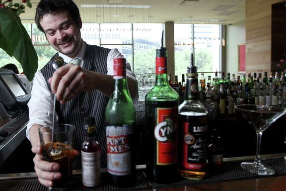 Chris Frankel, the new bar manager for RDG & Bar Annie, mixes up cocktails that are variations on classics to accompany tastes from the bar menu.