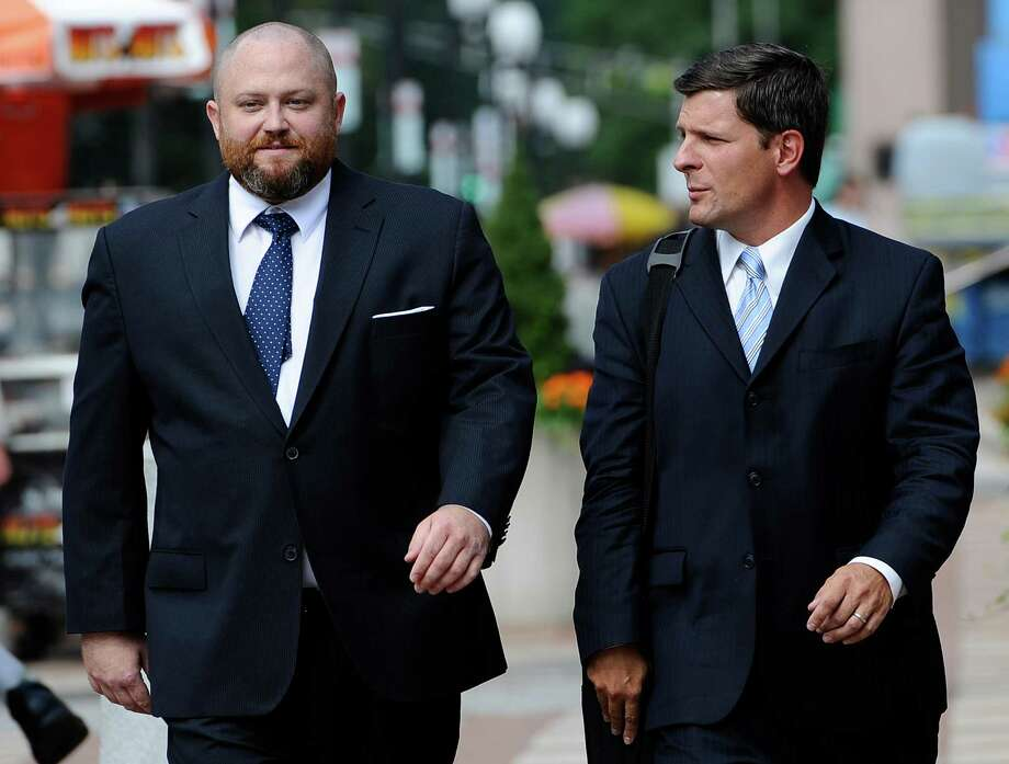 Robert Braddock Jr., former aide to ex-Connecticut House Speaker Christopher Donovan, left, arrives with his attorney Frank Riccio II, at federal court to be sentenced in New Haven, Conn., Tuesday, Aug. 27, 2013. Braddock was found guilty in May of campaign finance and conspiracy charges. (AP Photo/Jessica Hill) Photo: AP Photo/Jessica Hill, Associated Press / Associated Press