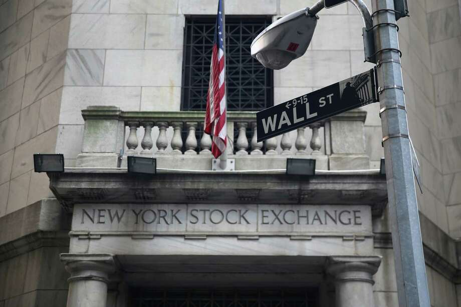 The New York Stock Exchange stands on Wall Street on August 27, 2013 in New York City. The Dow Jones Industrial Average fell 170 points on fears of a possible U.S. attack on Syria. Photo: John Moore, Getty Images / 2013 Getty Images