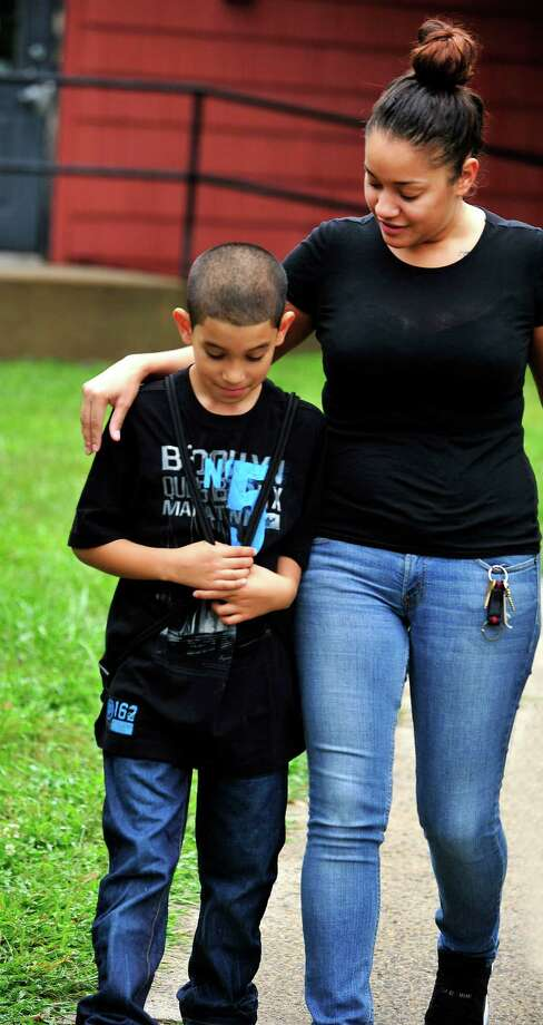 Raquel Rosa walks her son, Armani, 8, to his first day of school at South Street School in Danbury, Conn. Tuesday, Aug. 27, 2013. Photo: Michael Duffy / The News-Times