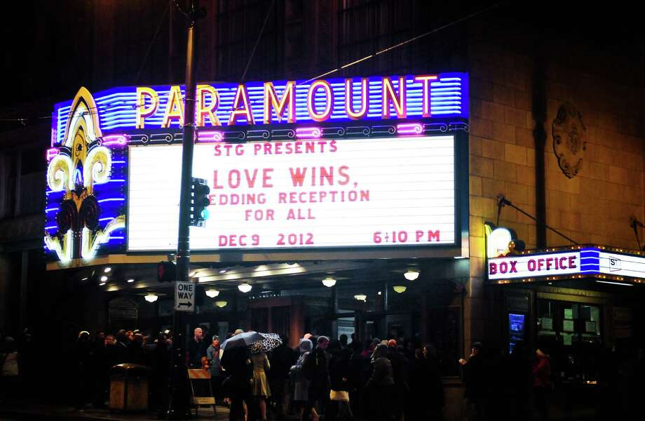 People gather outside the Paramount for Love Wins: A Wedding Reception For All in Seattle on Sunday, December 9, 2012. The free, public reception was to celebrate Referendum 74 taking effect at 12 a.m. this morning, allowing same-sex couples to legally wed. Photo by Lindsey Wasson, seattlepi.com. Photo: LNDSEY WASSON, Seattle Post-Intelligencer / SEATTLEPI.COM