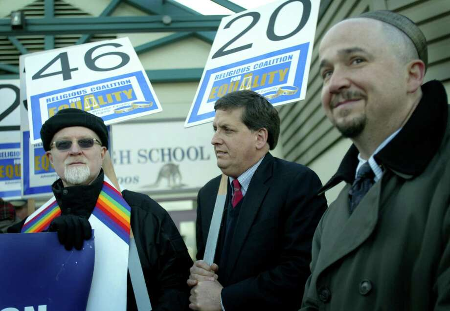 From left, Craig Darling, pastor of Seattle First Baptist Church, Rabbi Jonathan Singer of Temple Beth Am and and Cantor David Serkin-Poole of Temple B'nai Torah attend a rally to confront opponents of the Anderson-Murray gay rights Bill on December 28, 2005 at Lake Washington High School.  The school is where one of the churches opposing the bills meets on Sundays.  Photo by Joshua Trujillo/Seattle Post-Intelligencer Photo: Joshua Trujillo, Seattle Post-Intelligencer / Seattle Post-Intelligencer