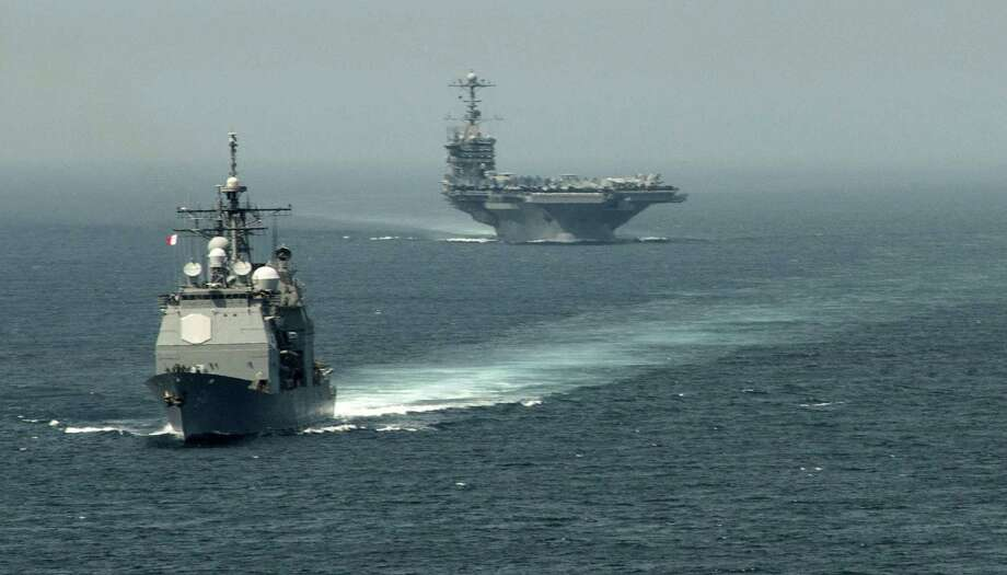 "The guided-missile cruiser USS Gettysburg, left, and aircraft carrier USS Harry S. Truman transit the Strait of Gibraltar Aug. 3. U.S. forces are ""ready to go"" if called on to strike Syria, Defense Secretary Chuck Hagel says. Photo: JAMIE COSBY, Handout / AFP"