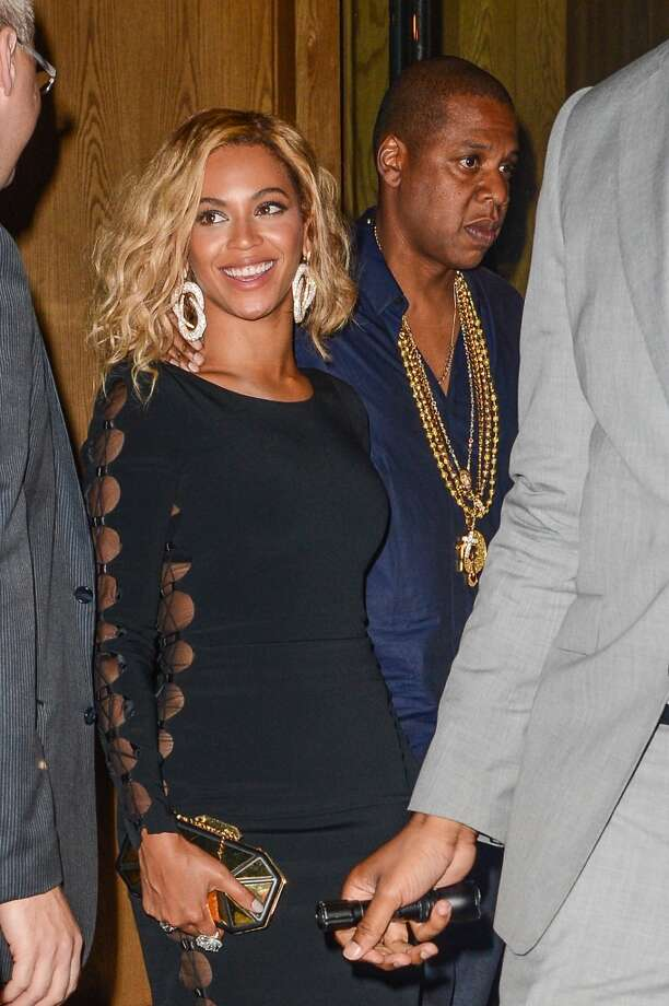 Singer Beyonce Knowles-Carter (L) and rapper Jay Z leave the Dream Downtown hotel on August 25, 2013 in New York City.  (Photo by Ray Tamarra/Getty Images) Photo: Ray Tamarra, Getty Images