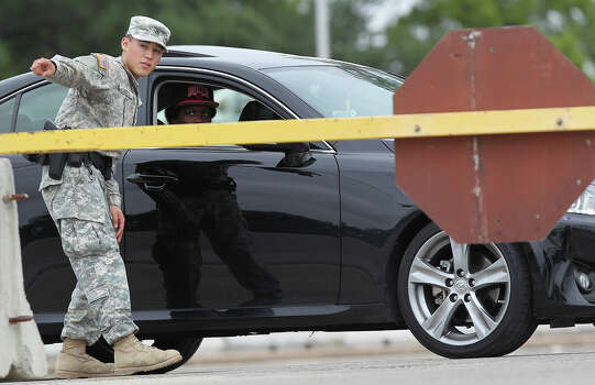 A military police officer checks traffic going into the Lawrence Williams Judicial Center during the second day of the sentencing phase in the capital murder trial of Maj. Nidal Hasan at Fort Hood, Texas, Tuesday, Aug. 27, 2013.  Photo: Jerry Lara, San Antonio Express-News / ©2013 San Antonio Express-News