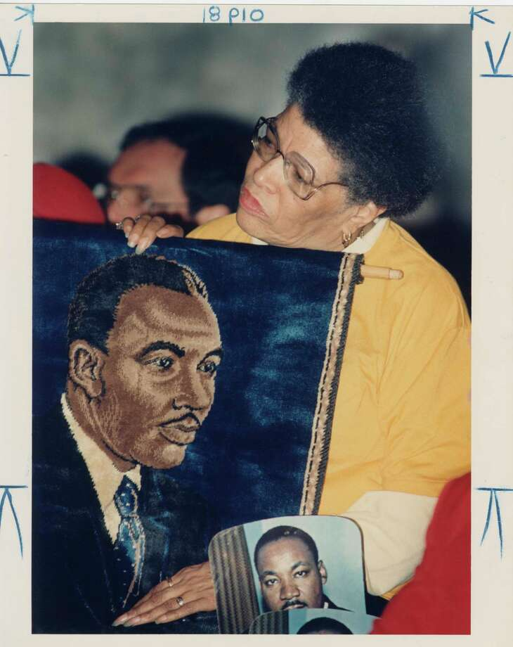 "Caption from verso of the print reads: Hellyne L. Summerise from Seattle holds her family's tapestry of Martin Luther King Jr. during the celebration held in his honor at the Capitol Rotunda in Olympia. When  Dr. King visited Seattle in 1960, she had marched with him. Hellyne was the wife of Bob Summerise, Jr. (1925-2010), a pioneer in Northwest radio broadcasting (radio stations KTAC, KQDE, KAYO, KZAM and Seattle soul station KYAC). He was the first African-American on-air personality and the first with an engineers license in this area.  He owned an influential record store named ""Summerise's World of Music"" on Jackson Street in Seattle. January 16, 1989. Photo: Mike Bainter/Copyright MOHAI, Seattle Post-Intelligencer Collection, 2000.107_print_KingMartinLutherSeattle_001 Photo: Mike Bainter, Copyright MOHAI, Seattle Post-Intelligencer Collection / Copyright Museum of History & Industry"