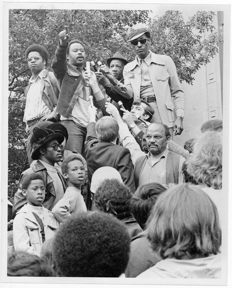 "Tyree Scott tells members and supporters of the United Construction Workers gathered at Seattle's Federal Courthouse, ""We're not going to wait!"" Larry Gossett stands at Scott's right, 1972. Copyright MOHAI, Seattle Post-Intelligencer Collection, 2000.107_print_CivilRights_005 copy Photo: Copyright MOHAI, Seattle Post-Intelligencer Collection / Copyright Museum of History & Industry"