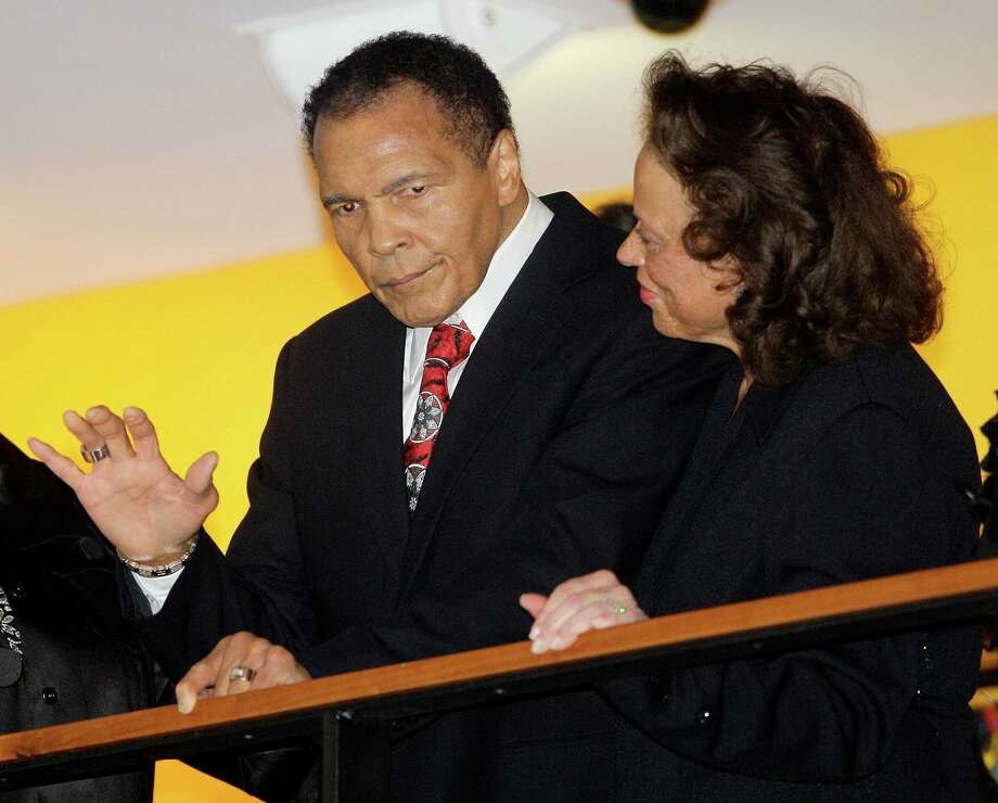 FILE - In this Jan. 14, 2012 file photo, boxing great Muhammad Ali, with his wife, Lonnie, right, waves to friends attending a celebration for his 70th birthday at the Muhammad Ali Center  in Louisville, Ky. Ali wants to recognize some of the greatest humanitarians around the world. The first-ever Muhammad Ali Humanitarian Awards will be presented Oct. 3 in Louisville, Ky. _ the former heavyweight champion's hometown. The Muhammad Ali Center said Tuesday, Aug. 27, 2013, that six awards will honor people ages 35 and under for making significant contributions for peace, social justice and other humanitarian causes. (AP Photo/Mark Humphrey, File) ORG XMIT: NY155 Photo: Mark Humphrey / AP