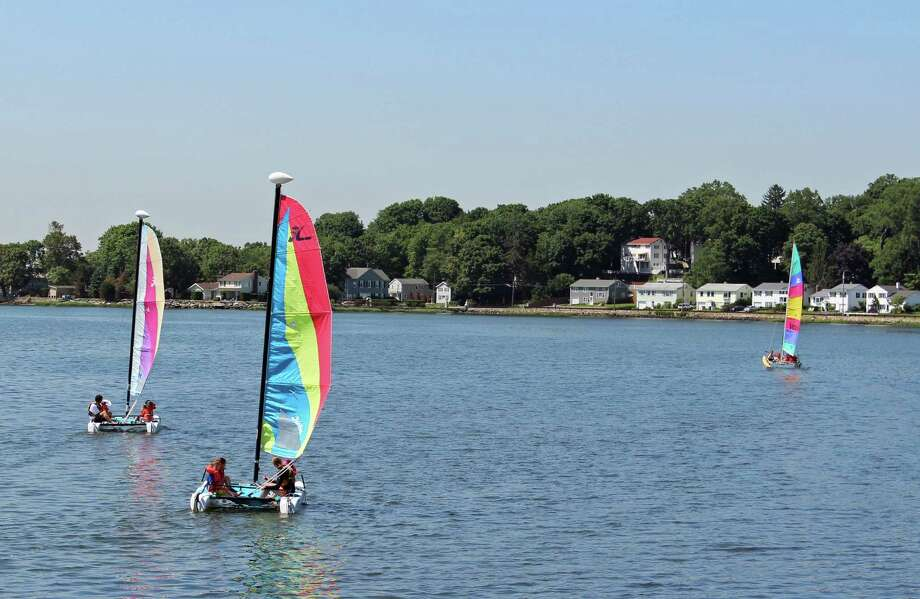 The Darien YMCA will hold its community open house on Saturday, Sept. 14 from 10 a.m. to 2 p.m. The event will include boat rides on the Yís catamarans, shown above. Photo: Contributed Photo