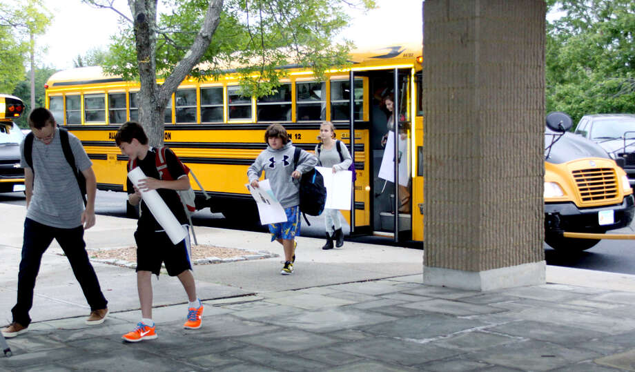 Students beat a path from their buses into Shepaug Valley Middle/High School on the opening day of schools in Region12. Aug. 26, 2013 Photo: Walter Kidd