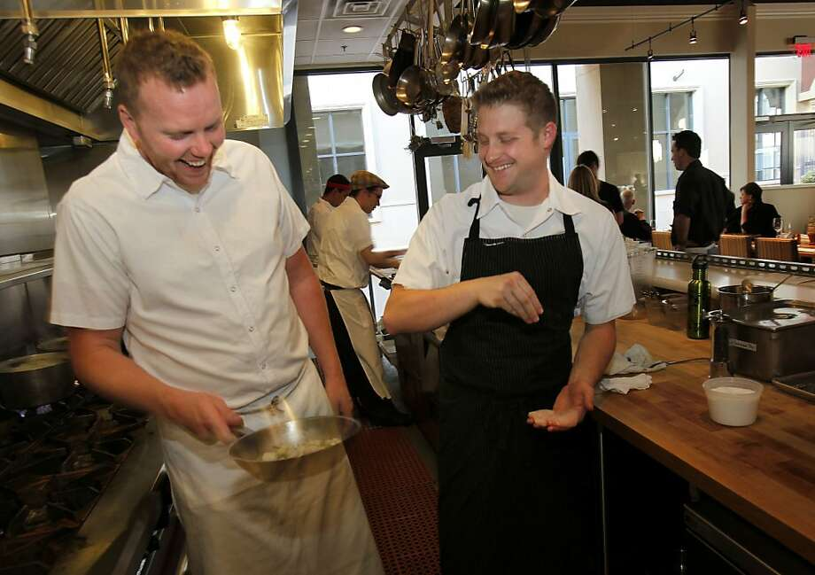 Tyler Rodde (left) and Curtis Di Fede in the kitchen area of Oenotri. Oenotri is a popular restaurant in downtown Napa, Calif. which features a large dining room with a view of the expansive kitchen. Photo: Brant Ward, The Chronicle