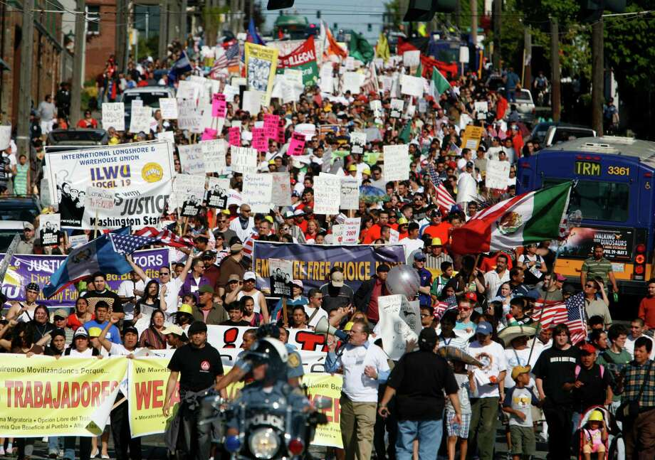 Marchers make their way down South Jackson Street during the annual May Day march in downtown Seattle on Friday May 1, 2009. Marchers called for immigration reform and worker rights. Photo by Joshua Trujillo/Seattlepi.com. Photo: Joshua Trujillo, Seattle Post-Intelligencer / seattlepi.com