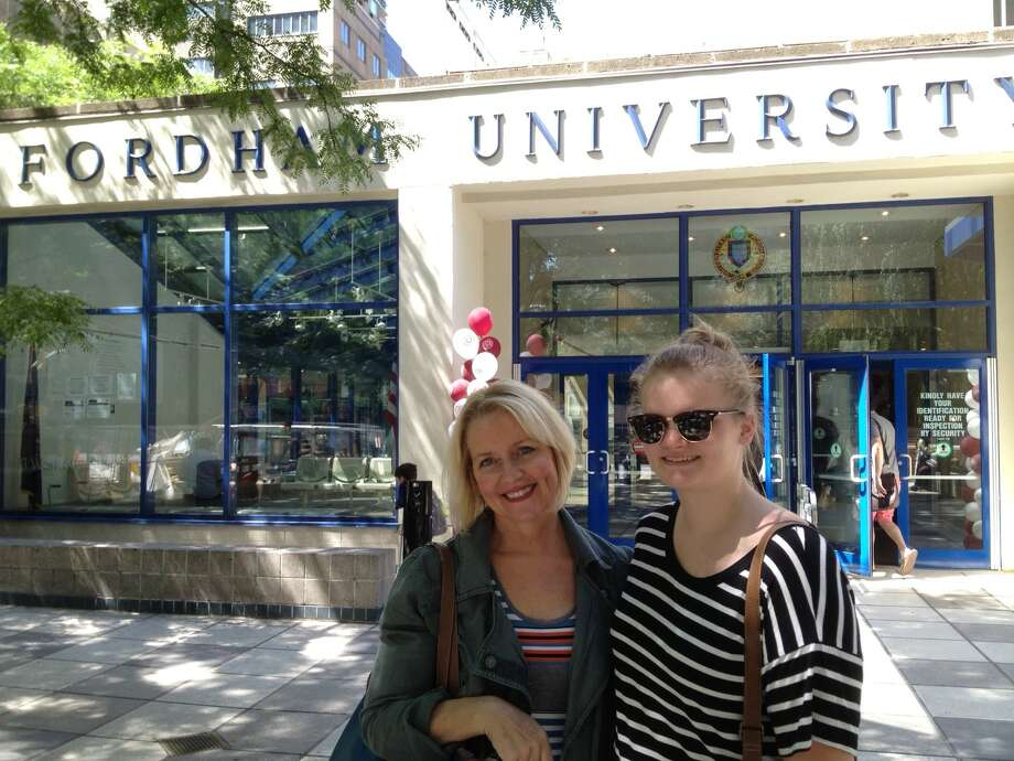 Caroline Grondahl and her mom, Mary Grondahl, in front of the academic building at the Fordham at Lincoln Center campus during freshman orientation. (Photo by Paul Grondahl)