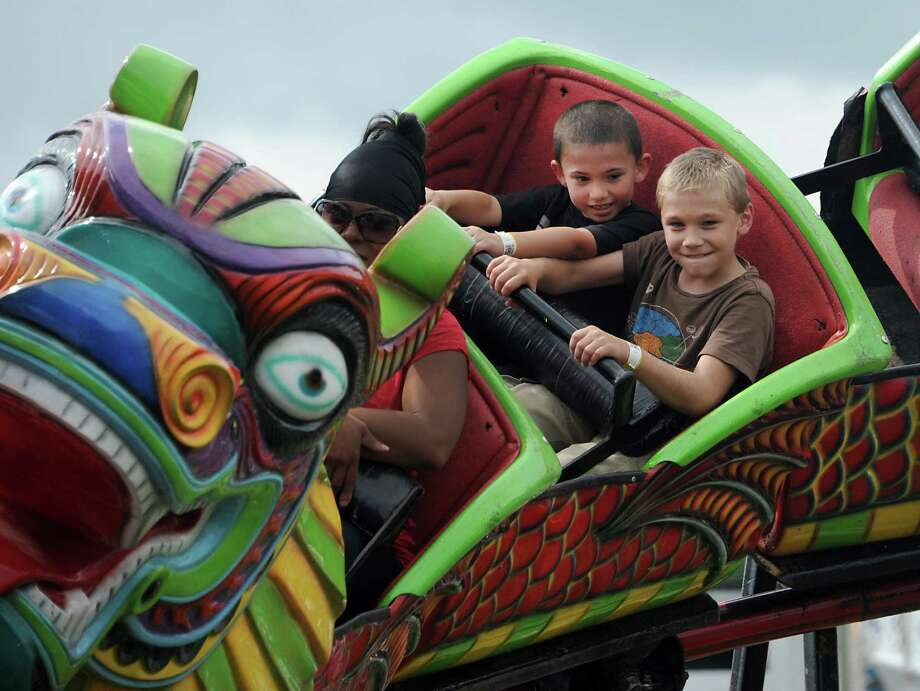 Jason Chategagne, 6, of Fonda, left, and Gabe Rauch, 11, of Fultonville ride the Orient Express rollar coaster Tuesday afternoon, Aug. 27, 2013, at the Fonda Fair Tuesday, Aug. 27, 2013, in Fonda, N.Y. (Lori Van Buren / Times Union) Photo: Lori Van Buren / 00023650A