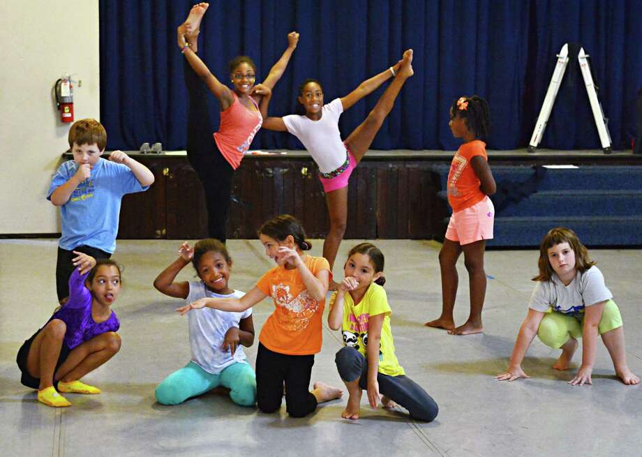 Students work on a performance during Read, Write and Perform Camp at the eba Theater Tuesday Aug. 27, 2013, in Albany, N.Y.  (John Carl D'Annibale / Times Union) Photo: John Carl D'Annibale / 00023611A