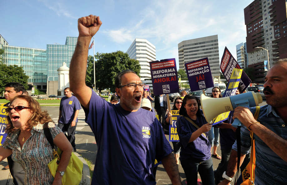 "Julio Zegarra, a member of the SEIU local 32BJ, shouts during the NAACP march through Stamford ending at Faith Tabernacle with a reading of Dr. Martin Luther King Jr's ""I Have a Dream"" speech on Tuesday, Aug. 27, 2013. Photo: Jason Rearick / Stamford Advocate"